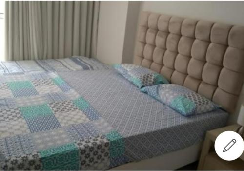 A bed or beds in a room at Expresso 2222 circuito do carnaval