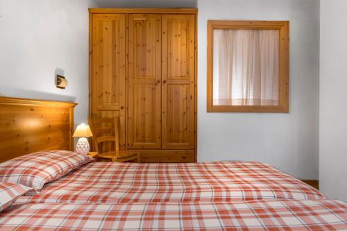 Letto o letti in una camera di Chalet Stelle Di Neve