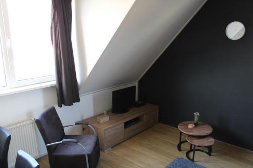 Een TV en/of entertainmentcenter bij Wijnberg Appartementen