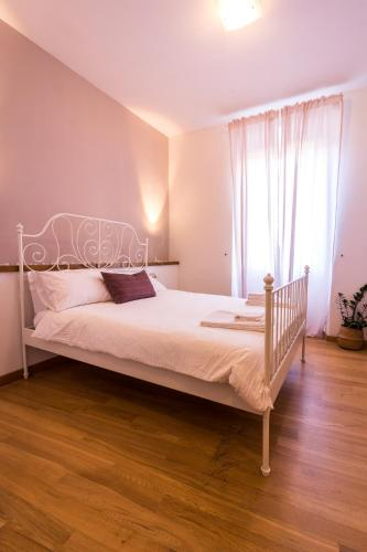 A bed or beds in a room at Il Terrazzino Su Boboli