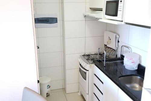 A kitchen or kitchenette at Suites em Boa Viagem
