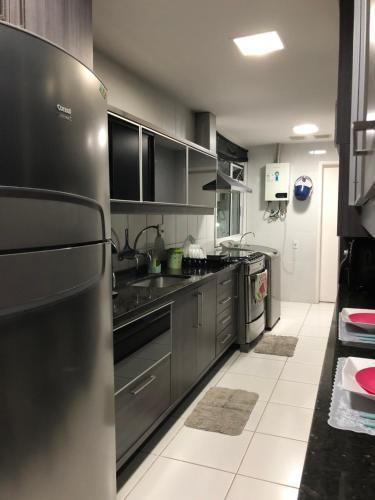 A kitchen or kitchenette at Praia Do Forte Alto Luxo