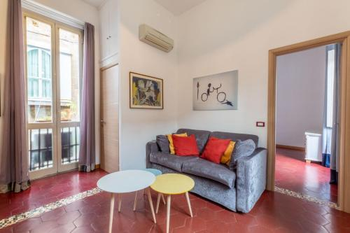 A seating area at Core de Roma Apartment