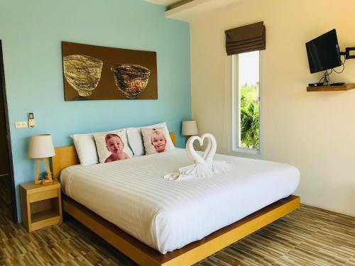 Ein Bett oder Betten in einem Zimmer der Unterkunft Seava House Ao-Nang Krabi