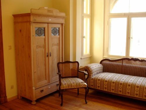 Ein Sitzbereich in der Unterkunft Asbach Appartements Weimar