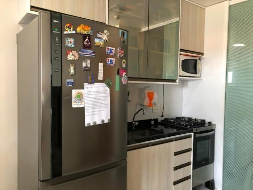 A kitchen or kitchenette at Lindo quarto e sala no hotel Mercury