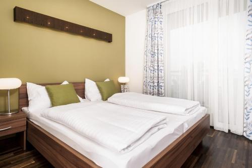Ein Bett oder Betten in einem Zimmer der Unterkunft IG City Apartments Campus Lodge