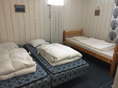 Säng eller sängar i ett rum på Eveline's House