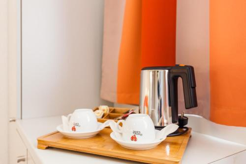 Coffee and tea making facilities at City Résidence Strasbourg Centre