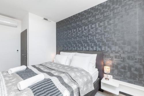 Ein Bett oder Betten in einem Zimmer der Unterkunft Bp Favor Apartments in Centre