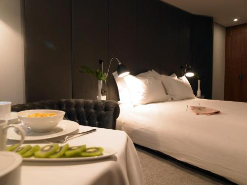 Un ou plusieurs lits dans un hébergement de l'établissement Altis Prime Hotel