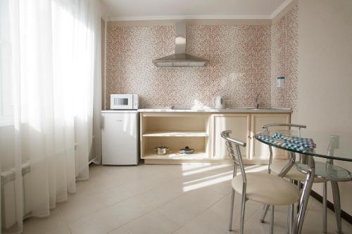 A kitchen or kitchenette at Vladykino Apart-Hotel