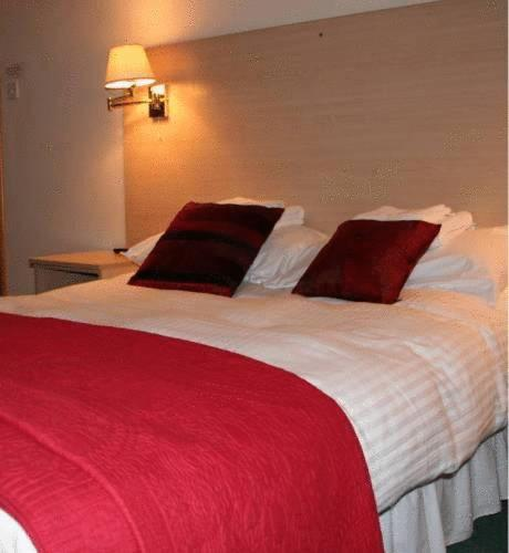 A bed or beds in a room at Holborn Hotel