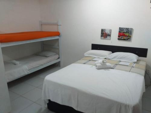 A bunk bed or bunk beds in a room at Studio Boa Viagem