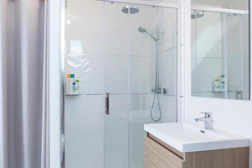 Ein Badezimmer in der Unterkunft Résidence Maréchal Leclerc