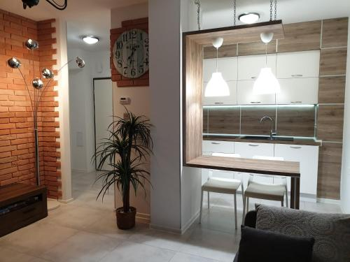 A kitchen or kitchenette at Lux Apartment Park