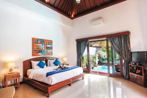 A bed or beds in a room at Villa Ayu