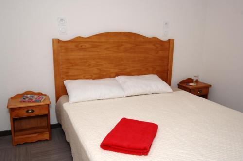 Llit o llits en una habitació de Résidence Odalys Pra Sainte Marie