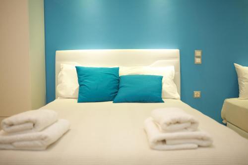Кровать или кровати в номере Ammos Beach