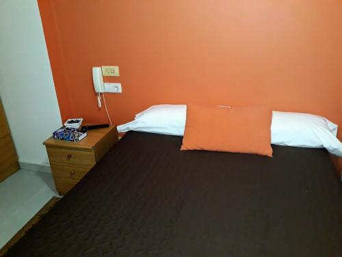 Cama o camas de una habitación en Porta Nova Apartamentos