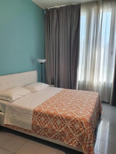 Letto o letti in una camera di House Aramis Aparthotel & PARKING GRATIS FREE - Milan Downtown - zona Navigli-canals