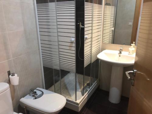 Un baño de Apartamentos Auhabitat Zaragoza, edificio de apartamentos turísticos con facilidad de parking