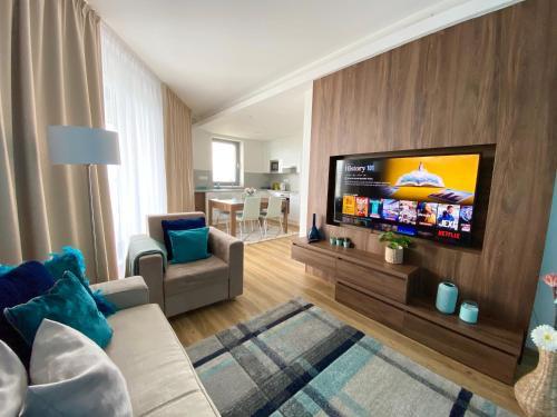 Телевизор и/или развлекательный центр в Hamberger Living