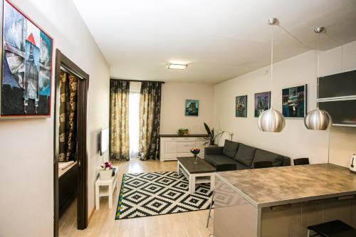 A kitchen or kitchenette at Murano Apartaments