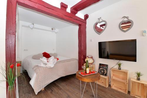 Un pat sau paturi într-o cameră la La stub de la Petite Venise