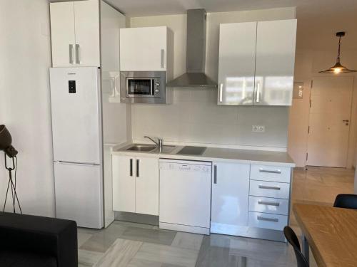 A kitchen or kitchenette at Montemar Puerto