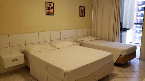 A bed or beds in a room at Garvey Flats