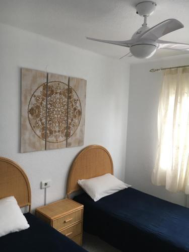 A bed or beds in a room at Apartamento con vistas