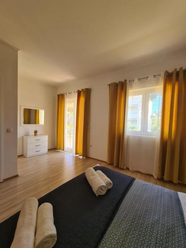 A bed or beds in a room at Apartments Marijan