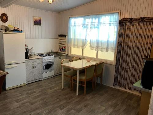 A kitchen or kitchenette at Letny Domik Holiday Home