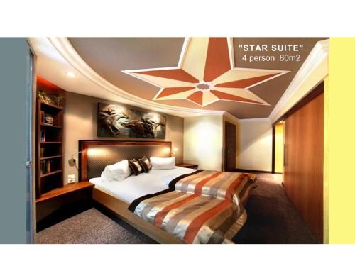 A bed or beds in a room at Grütter Luxury Apartments