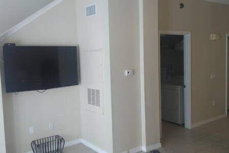 A television and/or entertainment centre at Townhome with hot tub and beautiful clubhouse