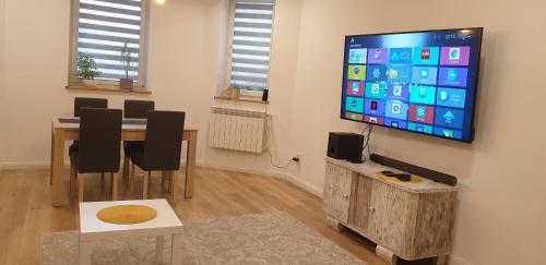 A television and/or entertainment centre at Słowackiego Apartment