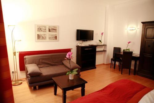 A seating area at La Scala Apartments