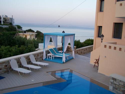 The swimming pool at or near Sea Breeze Hotel Apartments & Residences Chios