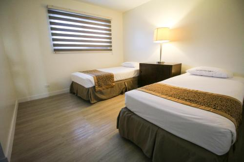 A bed or beds in a room at Oceanview Hotel and Residences