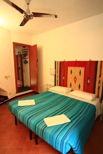 A bed or beds in a room at A Cà Da Nonna Di Callo Luca