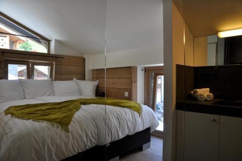 Ein Bett oder Betten in einem Zimmer der Unterkunft Akwa Levron