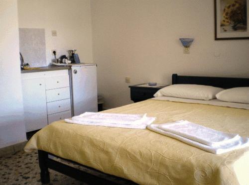 Cama ou camas em um quarto em Villa Maria Vekri