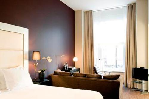 Un ou plusieurs lits dans un hébergement de l'établissement Apartment Nyhuset