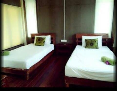 A bed or beds in a room at Hallo Villa Khanom