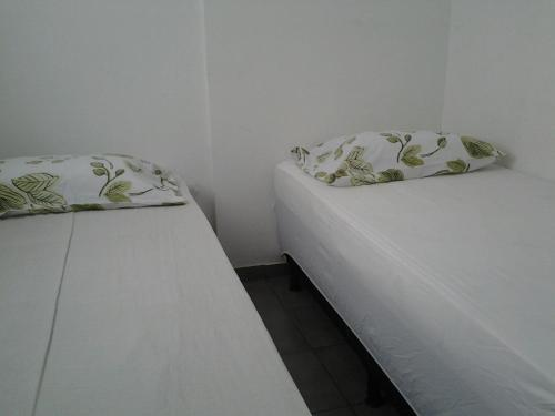 A bed or beds in a room at Apartamento Setor Bueno