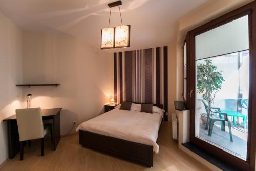 Łóżko lub łóżka w pokoju w obiekcie Just Apartments