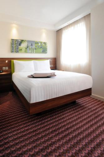 A bed or beds in a room at Hampton by Hilton Sheffield