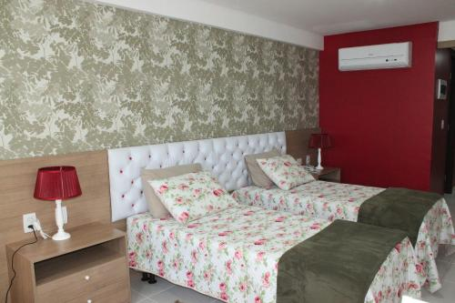 A bed or beds in a room at Betel Beach Flat