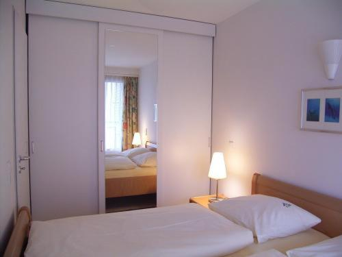 Кровать или кровати в номере TopDomizil Apartments Checkpoint Plaza